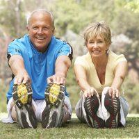 bigstock-Senior-Couple-Exercising-In-Pa-13911026
