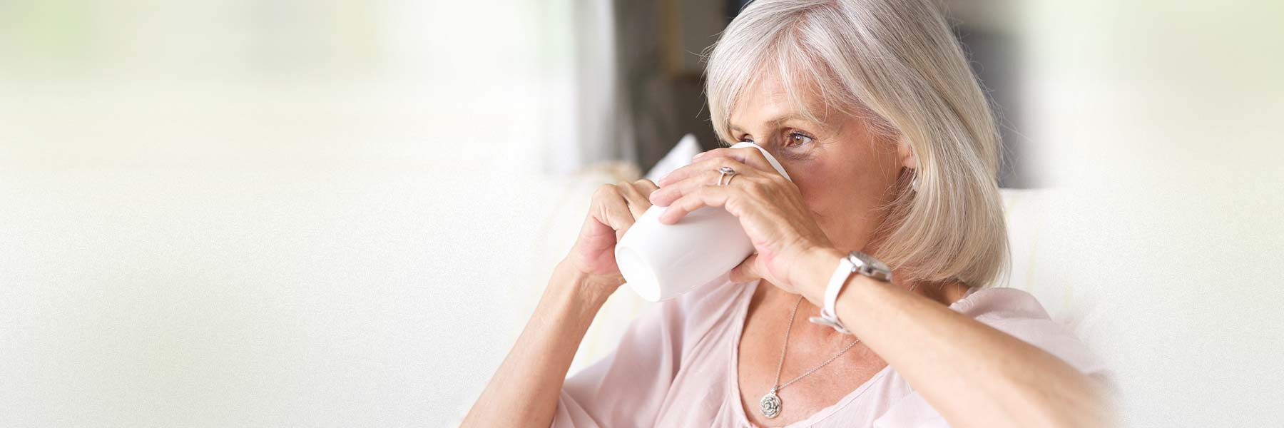 elderly-lady-on-couch-drinking